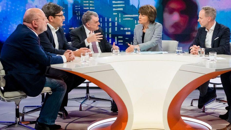 Moderatorin Illner (M.) mit ihren Gästen
