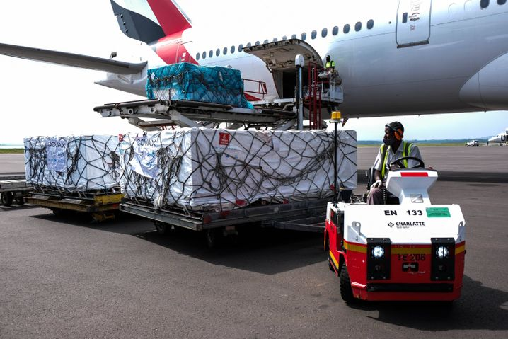 The arrival of a vaccine delivery at the airport in Entebbe, Uganda, on March 5