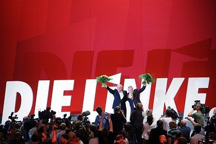Oskar Lafontaine and Lothar Bisky, co-chairs of the new Left Party, celebrate on Saturday.