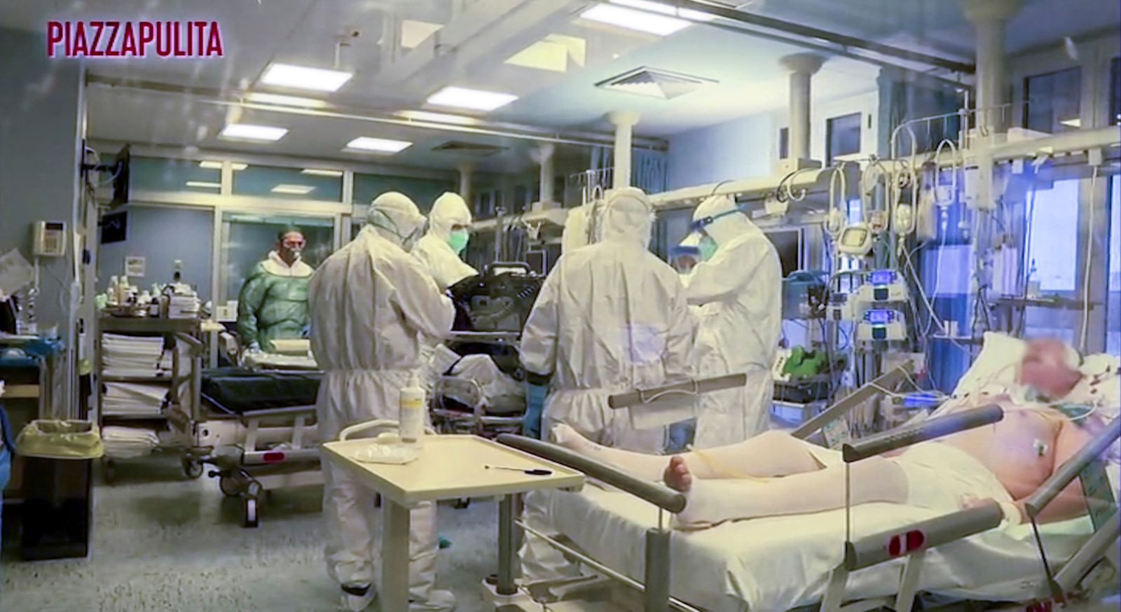 Medical staff in protective suits treat coronavirus patients in an intensive care unit at the Cremona hospital in northern Italy