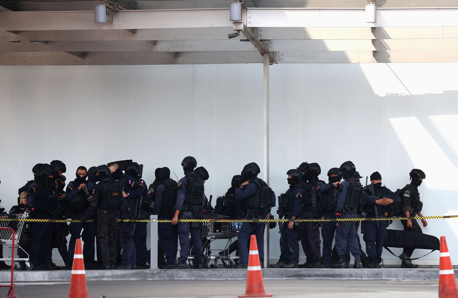 Thai security forces gather at Terminal 21 mall after completing their mission to stop a soldier on a rampage after a mass shooting, Nakhon Ratchasima