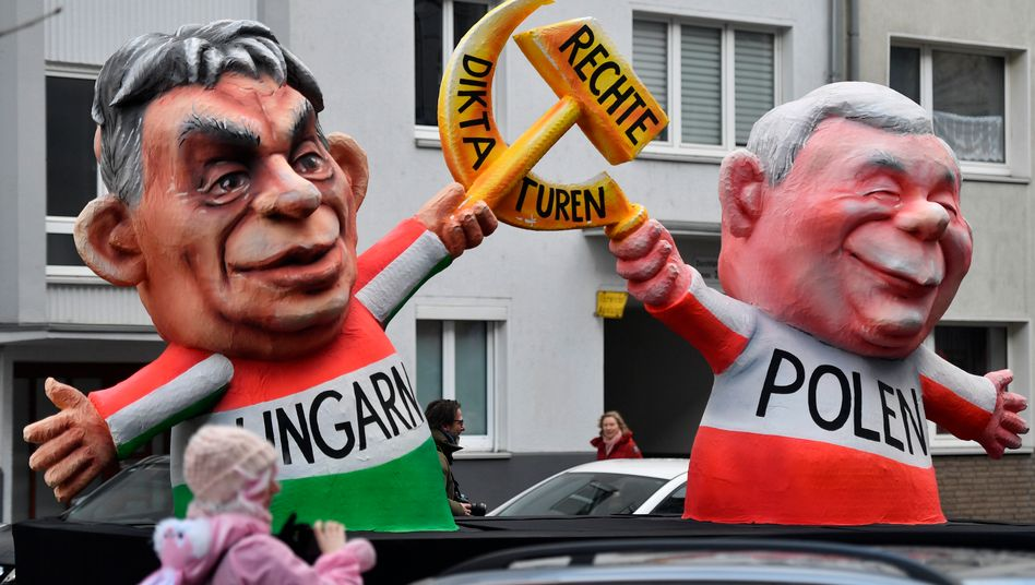Ungarns Premier Viktor Orbán und Polens starker Mann Jaroslaw Kaczynski als Karnevalsfiguren: Offener Verstoß gegen EU-Prinzipien
