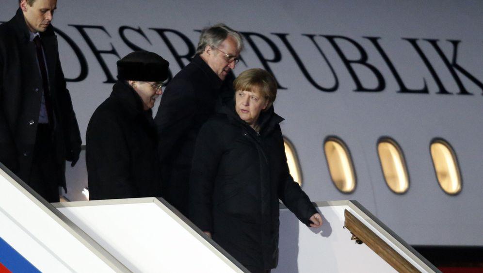 Ukraine-Konfliktgespräche in Moskau: Merkel und Hollande in heikler Mission