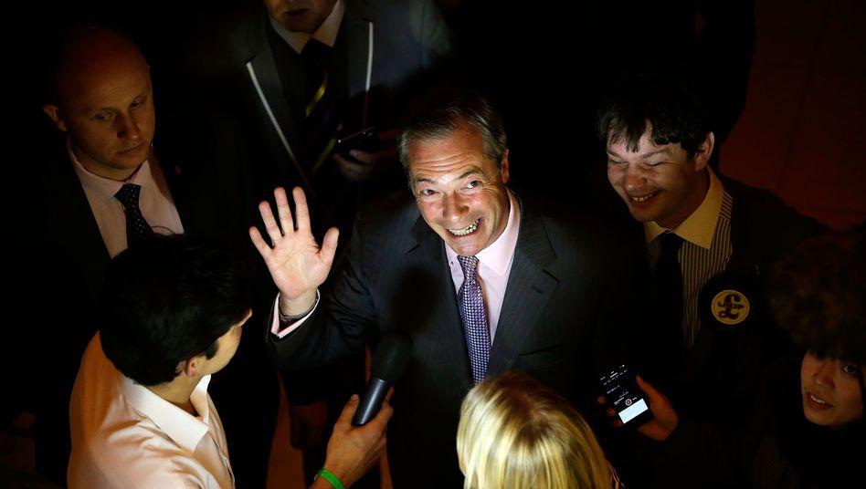 "UKIP leader Nigel Farage celebrates his party's ""historic"" victory on Sunday."