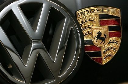 The emblems of VW and Porsche. Will the two carmakers merge?