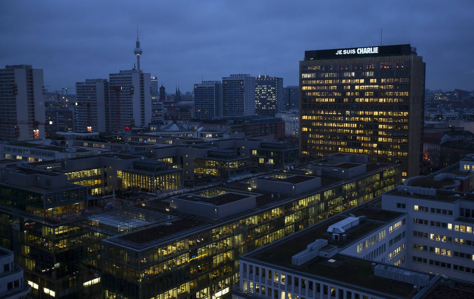 "An electronic advertising board displays ""Je suis Charlie"" (I am Charlie) on the roof of the German Axel Springer publishing group headquarters in Berlin"