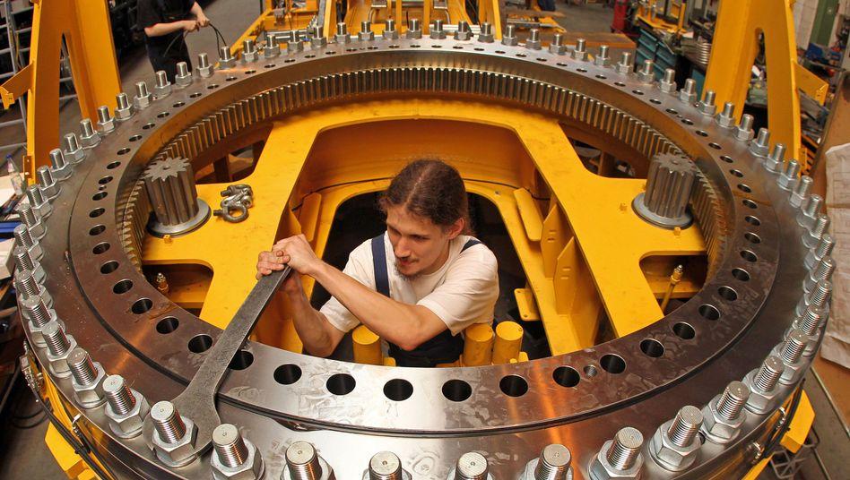 An engineer assembling a railway crane made by Kirow Ardel. Demand for German industrial goods is declining.