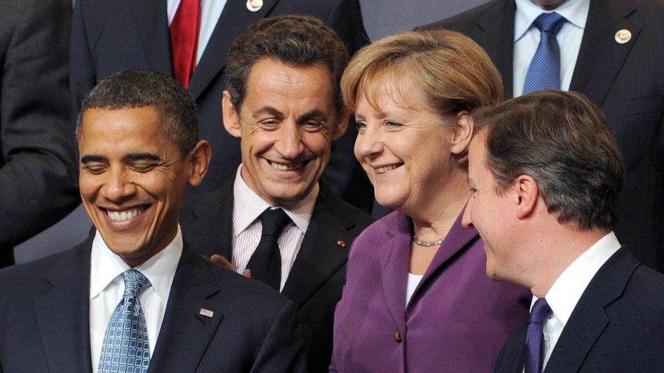 Politiker Obama, Sarkozy, Merkel, Cameron: Alle wollen etwas von Washington