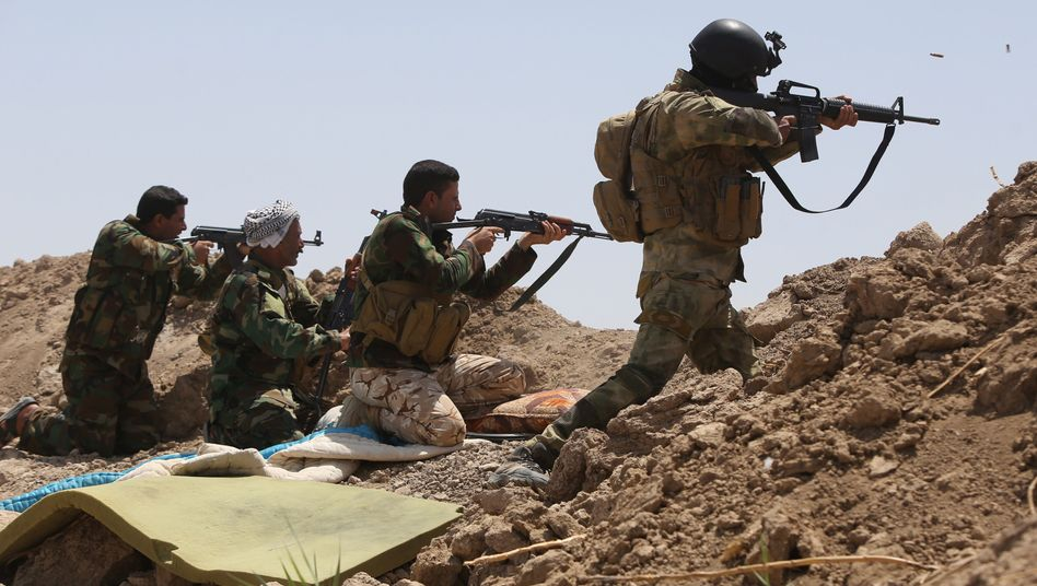 Irakische Soldaten und schiitische Milizionäre (am 19. Mai): IS als gemeinsamer Gegner