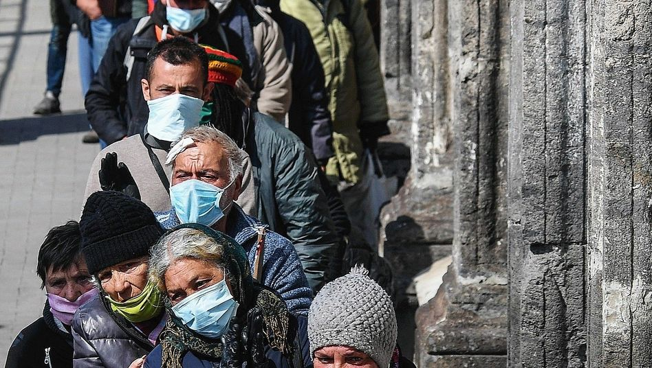 """People in Naples waiting for food handouts: """"Are we together or are we not?"""""""