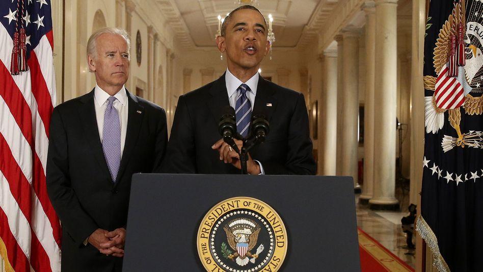 US-Präsident Obama (r.), Vize Biden: Wichtiger diplomatischer Erfolg