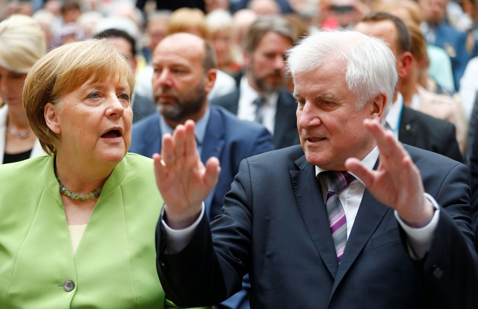 German Chancellor Merkel and German Interior minister Seehofer attend an event to commemorate victims of displacement in Berlin