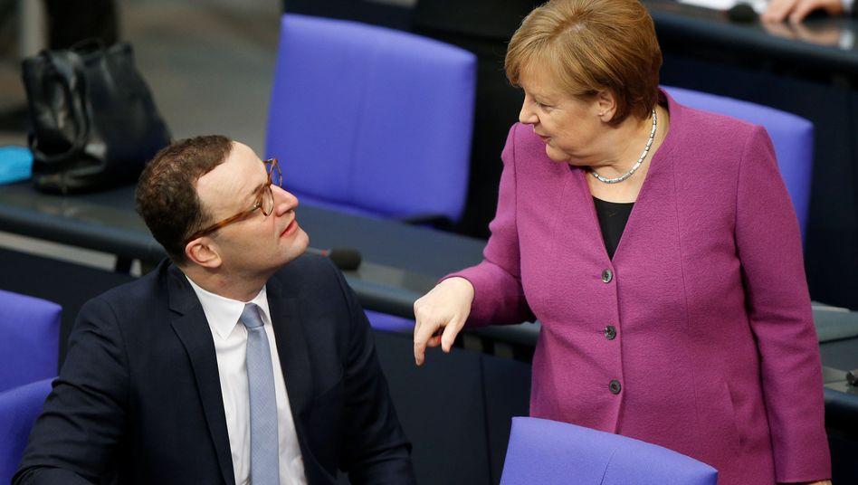 Jens Spahn und Angela Merkel