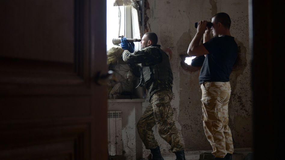 Ukrainische Soldaten nahe Donezk (Bild vom Samstag): Neue Kämpfe