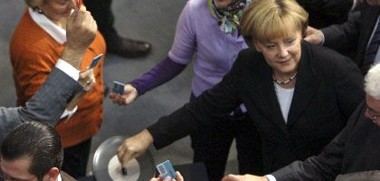 German Chancellor Angela Merkel at the bailout vote on Friday: Only the Left Party and Greens opposed the package.