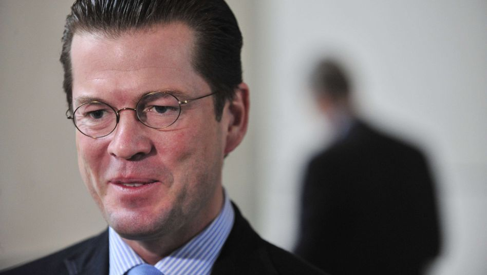 Defense Minister Karl-Theodor zu Guttenberg: His popularity may have rescued him.