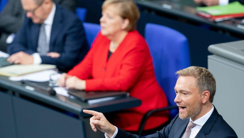 FDP-Chef Lindner (r.), Kanzlerin Merkel, Finanzminister Scholz: Welche Normalität ist möglich?