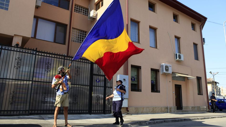 A protester outside suspended President Basescu's campaign headquarters in Bucharest.
