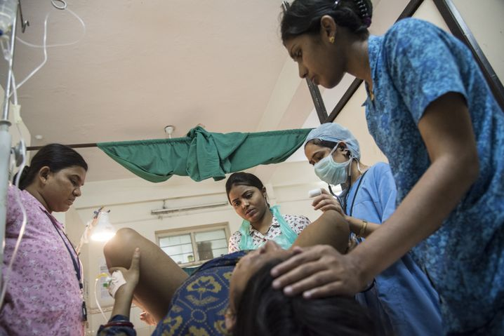 Rekha Marandi (center) and her colleagues are among the very few trained midwives in India. The government is planning on changing that.