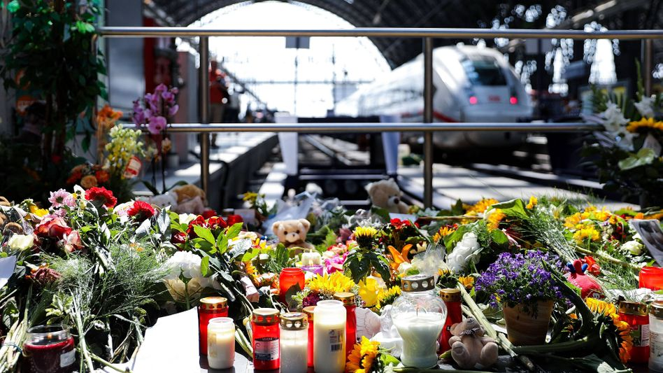 Flowers laid at the site where an 8-year-old boy was pushed in front of a train on Monday.