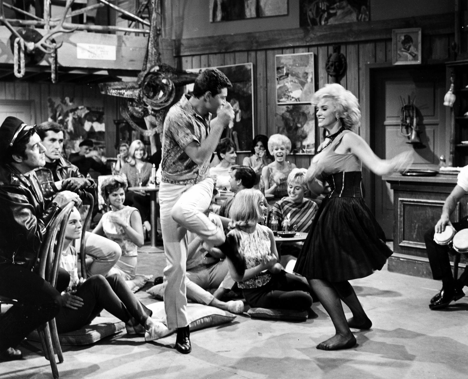 Wate On Werbung - BEACH PARTY, 1963. /nFrankie Avalon and Eva Six dancing the Twist in a scene from 'Beach Party,' 1963.