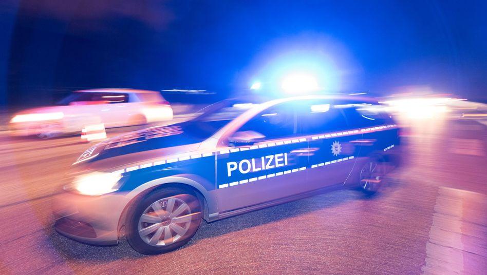 Polizeifahrzeug im Einsatz (Symbolbild)