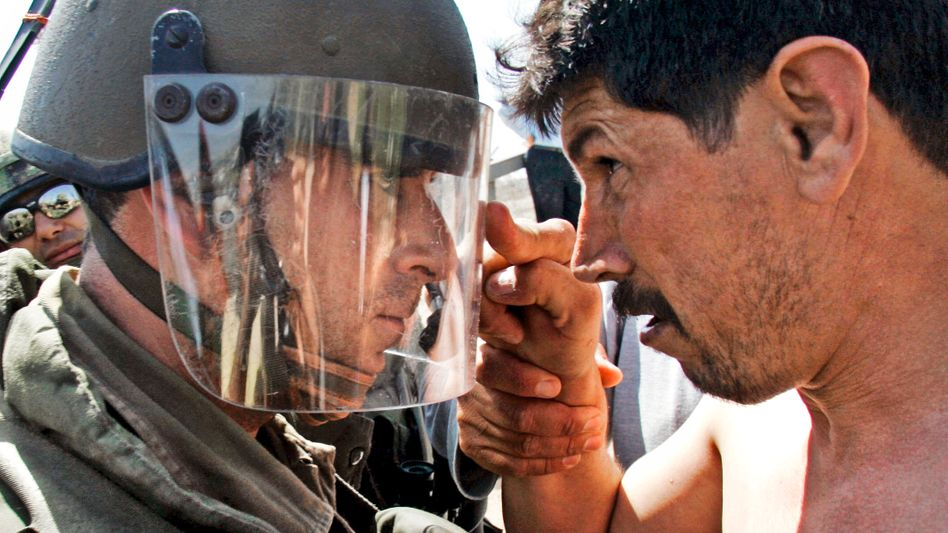 Confrontation: An Israeli soldier and a Palestinian demonstrator near Ramallah.