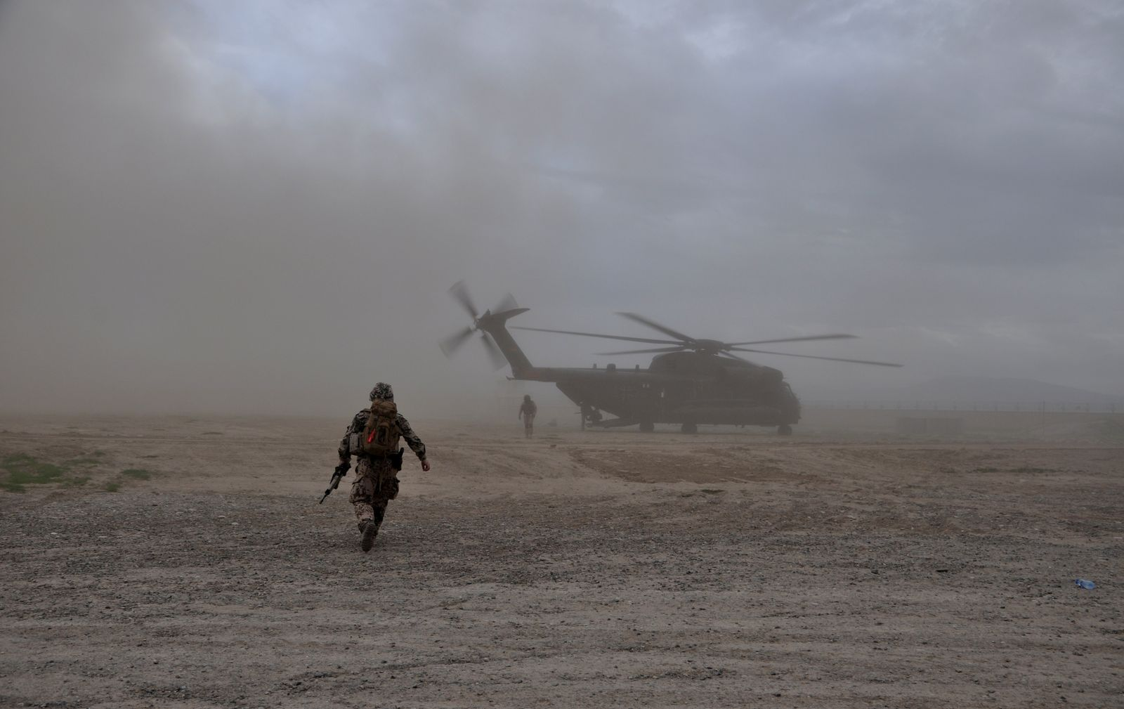 A soldier walks towards a CH-53 helicopter in Kunduz
