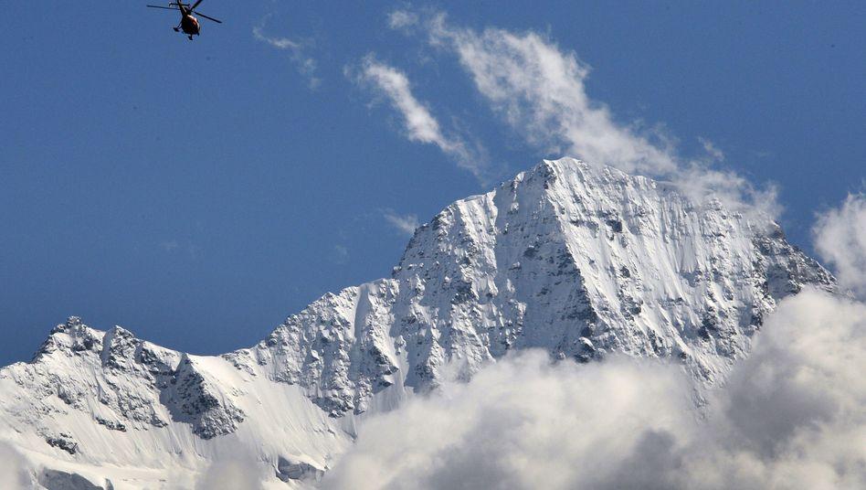 The glacier is located below the Jungfrau peak, shown here, in the Bernese Alps.