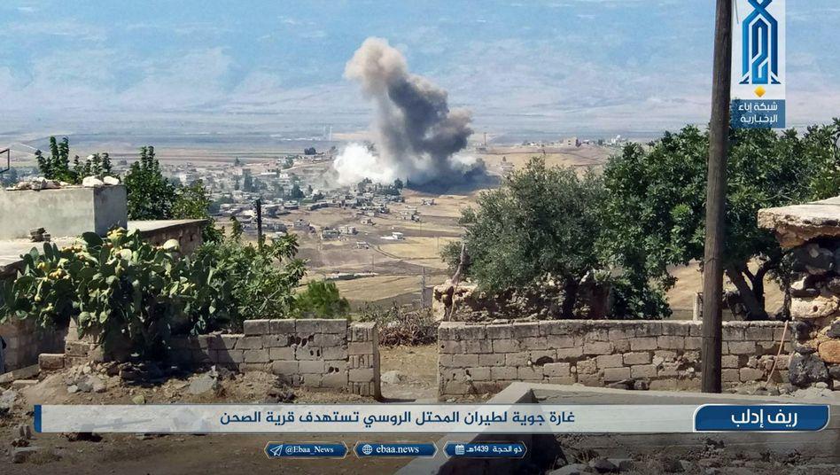 Smoke rises from a village near Idlib following an airstrike.