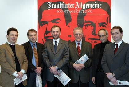 In this 2003 file photo, the FAZ editorial board and their art director accept a design award for the Sunday edition, which was started in 2001. From left, Frank Schirrmacher, Günther Nonnenmacher, Berthold Kohler, Dieter Eckart, art director Peter Breul, Holger Steltzner. Co-editor Dieter Eckart was replaced by Werner D'Inka in 2005.