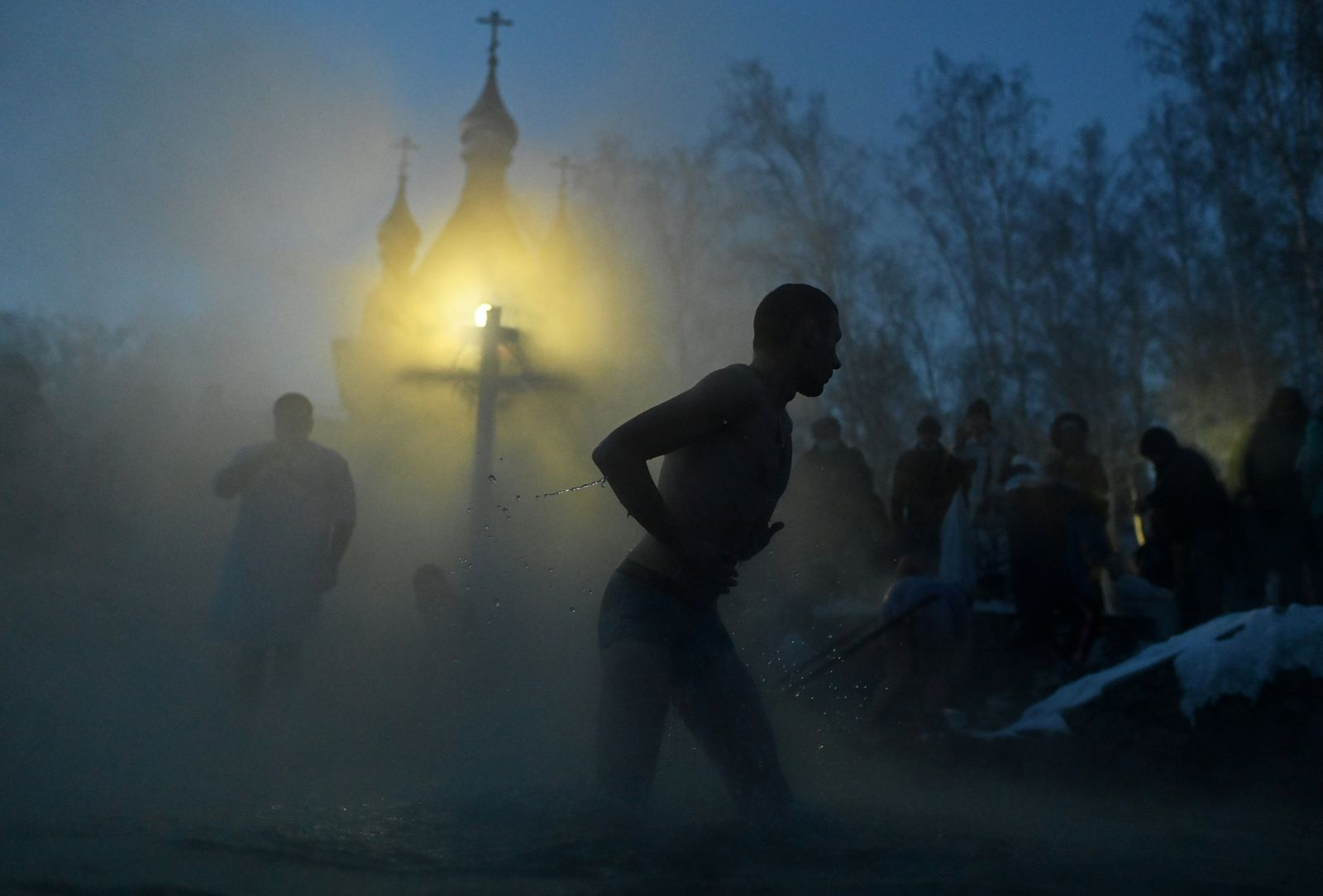 People take a dip during celebrations of the Orthodox Christian feast of Epiphany in Omsk Region