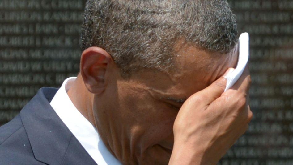 Obama tupft sich den Schweiß von der Stirn am Memorial Day: Heißestes Jahr der USA