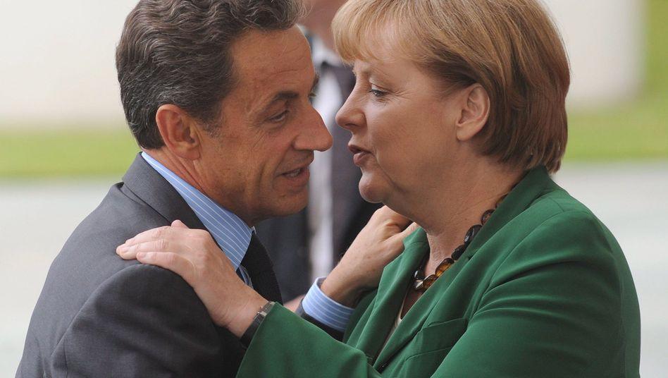 Will German Chancellor Angela Merkel see eye to eye with French President Nicolas Sarkozy at the crisis meeting on Tuesday?