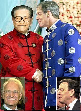 Jiang Zemin und George W. Bush haben es vorgemacht: Im richtigen Outfit versteht man sich gleich viel besser, selbst wenn man nicht immer einer Meinung ist. Vielleicht sollten es die beiden Kanzleraspiranten auch mal auf chinesisch versuchen...