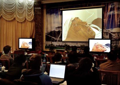 Foreign journalists attending a briefing in Lhasa watch a Chinese authorities' video allegedly showing a riot victim.