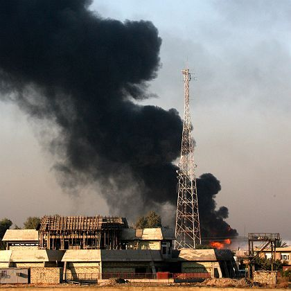 Iraq's al Dora refinery blazes after being hit by a mortar last week.