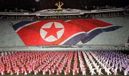 Workers and students celebrate both Kim Jong Il and his late father in the Arirang Festival at Pyongyang's May Day Stadium.