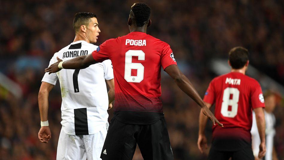 Cristiano Ronaldo (l.), Paul Pogba