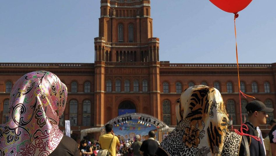 Two women of Turkish background attending a festival in front of the Berlin City Hall.