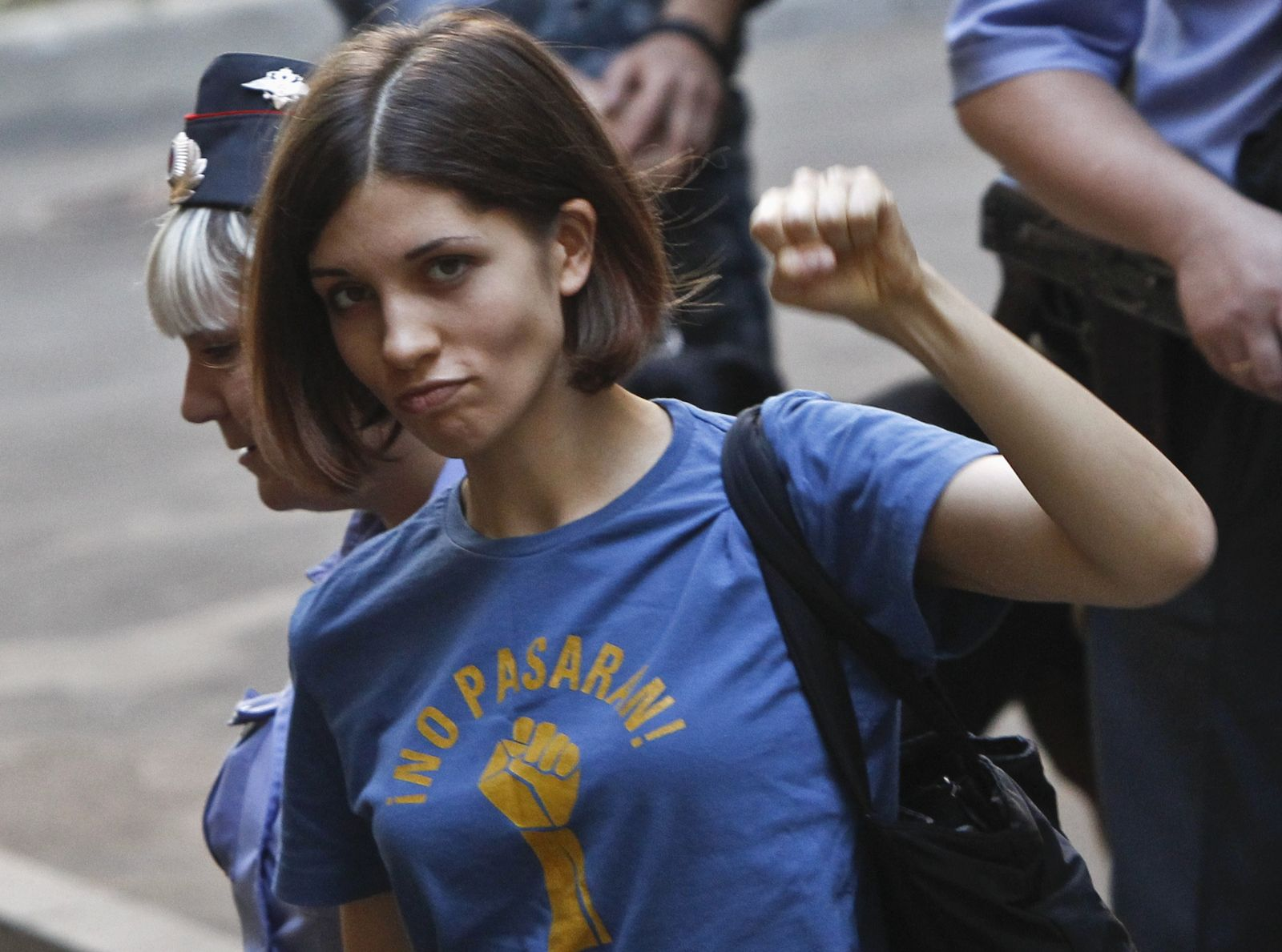 """Tolokonnikova, a member of the female punk band """"Pussy Riot"""", is escorted by police before a court hearing in Moscow"""