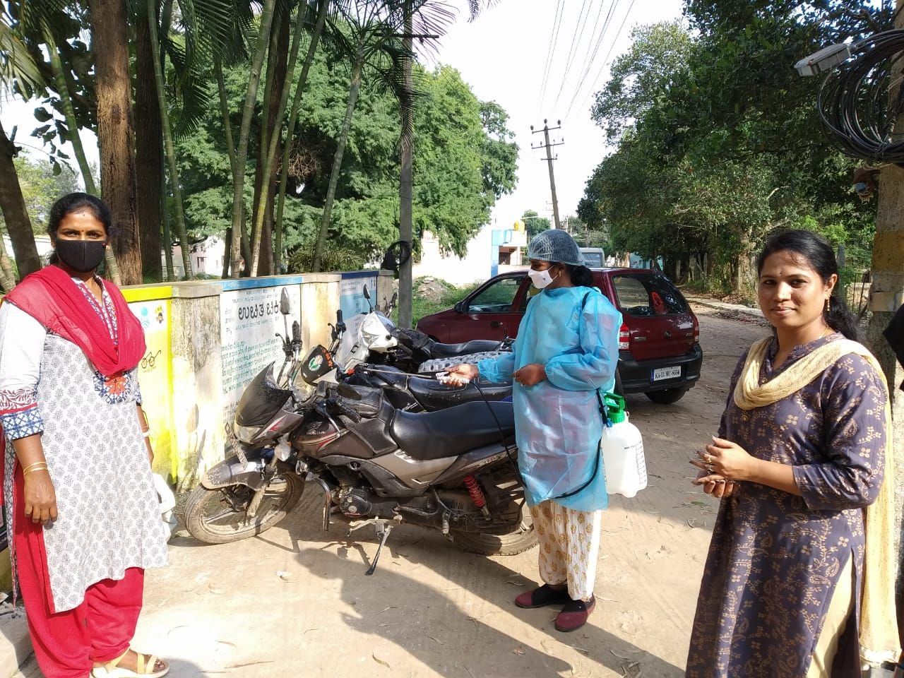 2. Kalavathi sanitizing a parking lot in Bangalore