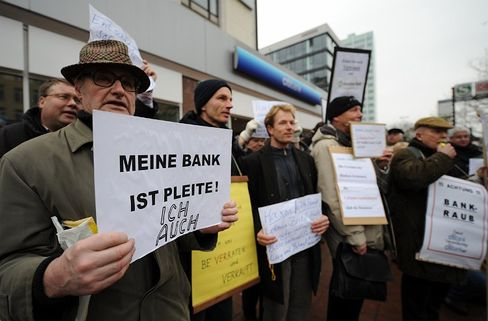 """""""My bank is broke -- I am too"""": German investors protest outside a Citibank branch in Hamburg."""
