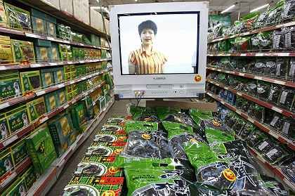 Video promotions in a brand-new supermarket in Shenyang, China. China's economy continues to expand at a rapid rate, with 11.5 percent growth in the third quarter of this year.