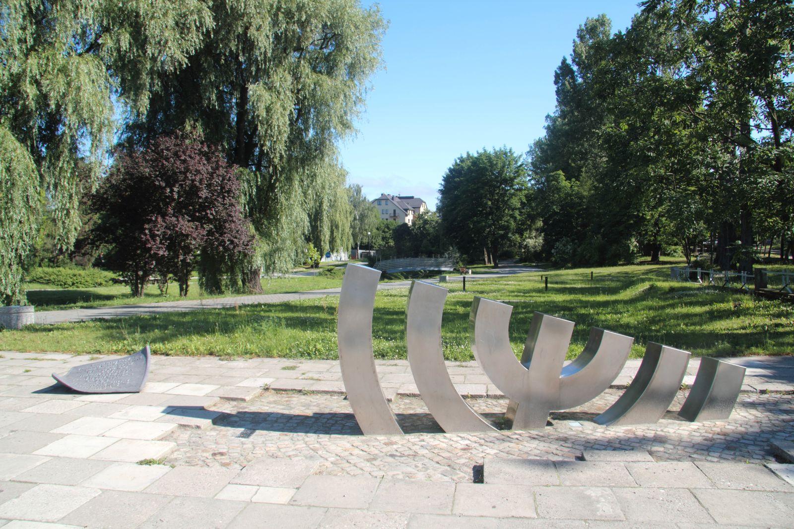 Jewish Menorah, partially buried, commemorating the Kielce pogrom against the Jewish community, Poland