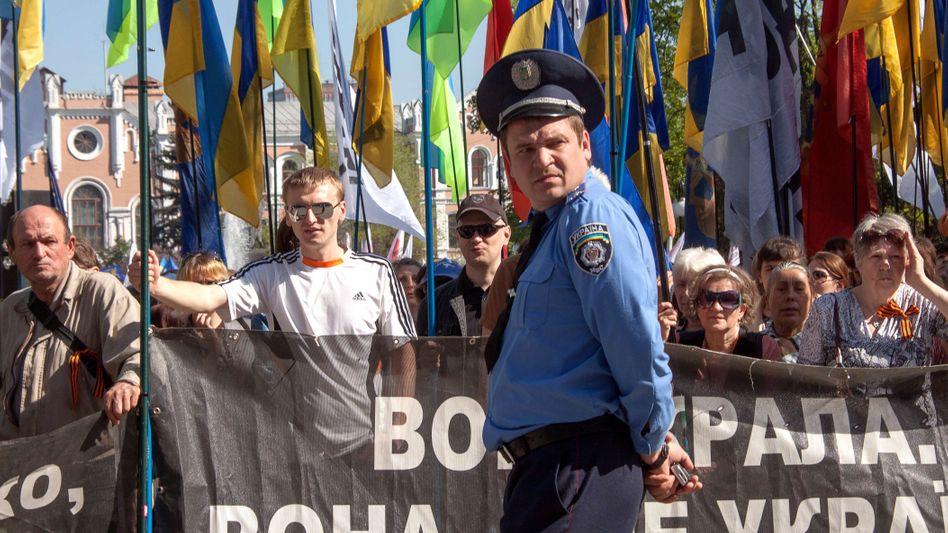 Supporters of Ukrainian jailed opposition leader Yulia Tymoshenko, rally outside a court building in Kharkiv on April 28, 2012.