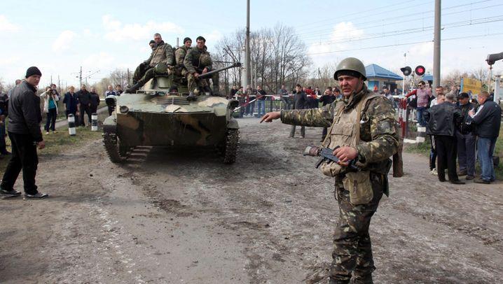 Panzer mit russischer Flagge: Fahnenflucht in der Ostukraine
