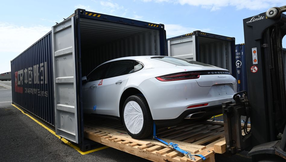 A Porsche sports car is loaded into a container in the German port city of Bremerhaven.