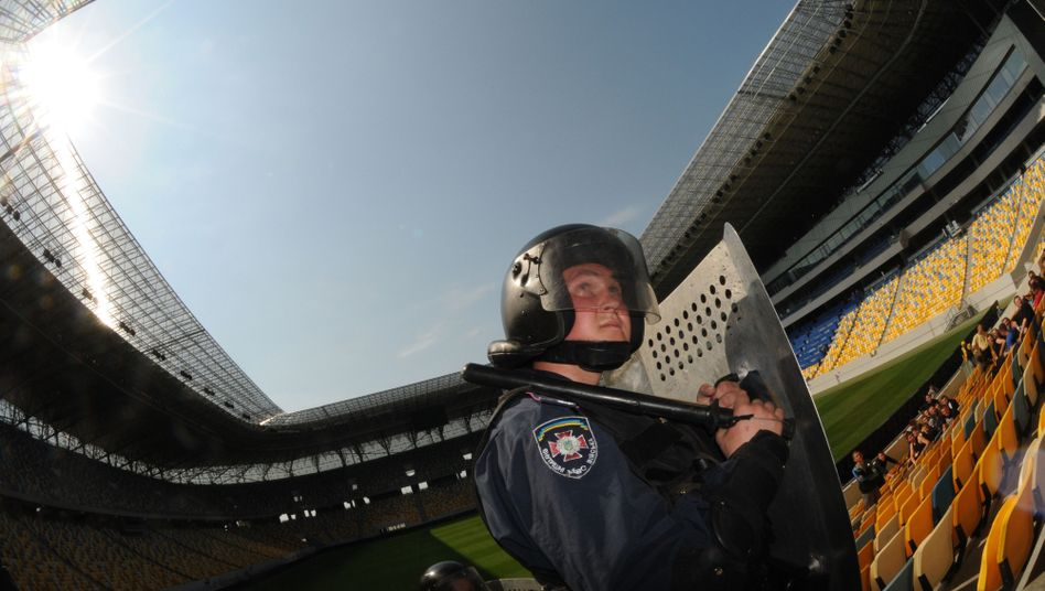 Riot police conduct an exercise at a stadium in Lviv as part of preparations for the upcoming Euro 2012 championship.