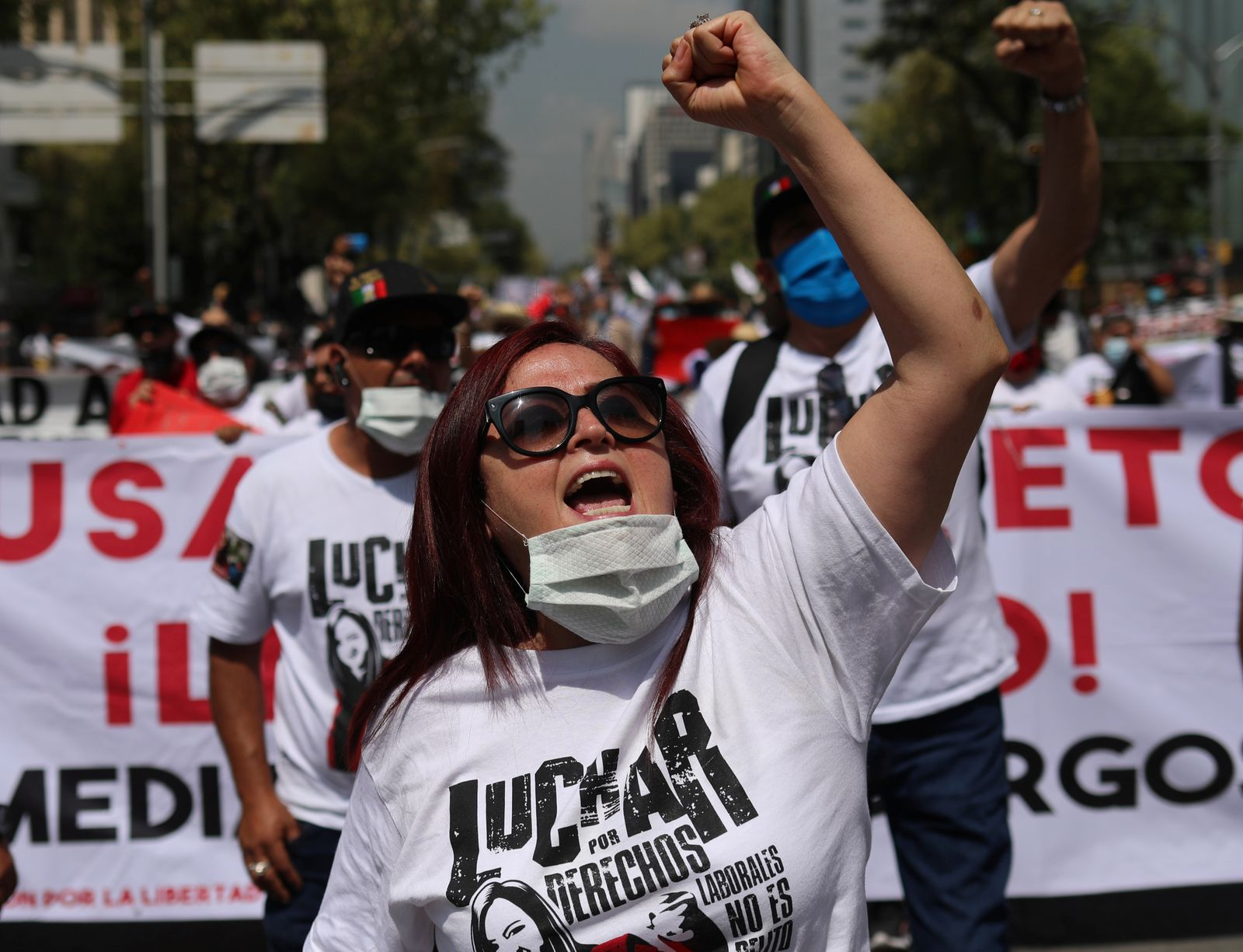 Mexican labor lawyer Susana Prieto leads a demonstration with supporters and workers along the streets in Mexico City